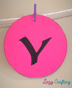 circle banner with letter y hanging by tiny clothespin