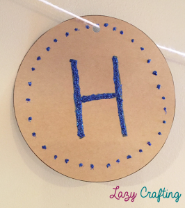 circle banner with letter h and glitter