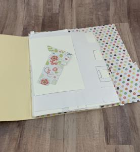 white scrap paper in manila folder