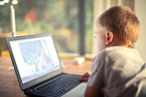 boy watching computer