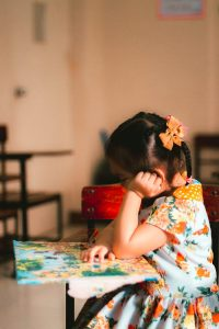 girl looking at school activity